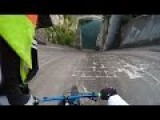 Cyclist Rides Vertical Down Wall Of Dam Into Water