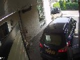 Car Drags Vacuum Cleaner While Pulling Out Of Garage