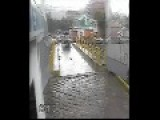 Car Barely Makes It Over A Bridge In Time During Flooding