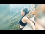 Couple Extreme Leaping Off Bridge With Hooks Under Their Skin