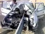 Car Impaled --- Occupants OK