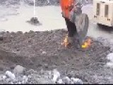 Contaminated Soil Ignites While Being Removed