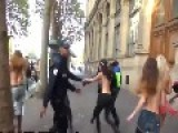 Cop Tries To Catch Topless Protester - Faceplants Into Cement Wall