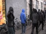Commemoration Of The Perpetrator: Masked Men Remove Flowers