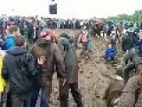 Concert Crowd Delight In Spontaneous Mud Slinging