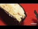 Cutting European Krembo Chocolate Marshmallow In Ultra HD 4K