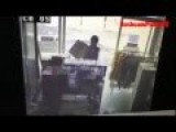 Car Crashes Into Laundry Filmed By CCTV