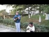 Chinese Man Serenades Woman With A Guitar