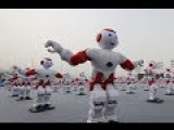 Do The Robot! 1,007 Robots Dancing In Unison Bags World Record