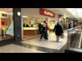 Drunk Man Kicking And Touching People In The Mall