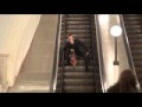 Drunken Man Lost His Balance On An Escalator