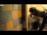 Drunk Guy Drinking From Bathroom Urinal