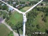 Drone Video Captures Monk Sunbathing On Top Of A Wind Turbine
