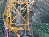 Daredevil Swings From Crane