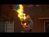Doing A Backflip While Breathing Fire Under A Giant Water Balloon