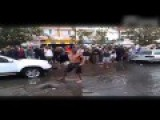 Drunk Man Show Off His Muscles In Flooded Street After Work