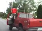 Driver Tries To Stand On Truck While Driving