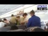 DRUNK FEMALE: DIVERTS PLANE, ATTACKS DOOR IN FLIGHT, FORCES EMERGENCY LANDING