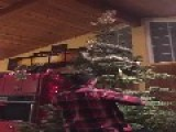 Dad Cuts Down Christmas Tree Indoors