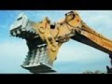 Excavator Destroying Some Building, Rocks, Etc... In Construction Site