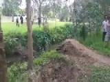 Flying Over A Creek On A Moped
