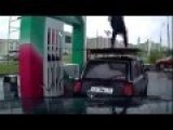 Funny Man Back Flips On A Car At Gas Station