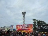 Festival Goers Toss Bottles At Zipliners At Download Festival 2013