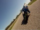 Female Roadracer Tearing Up The Track On Her Motorcycle