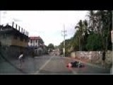 Female Biker With No Helmet Falls Due To Ball Rolling On The Road