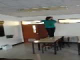 Guy Kicks Light Off In Classroom