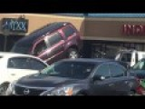 Guy Tries To Free SUV From Tow Truck