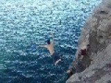 Guy Tries To Catch Frisbee After Leaping Off Cliff