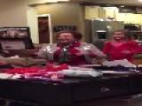 Grandma Opens Firefighter Calendar Christmas Gift