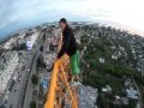 Guy Handstands On Crane