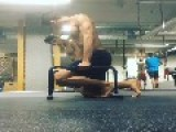 Guy Kicks Back And Forth While On Short Parallel Bars