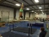 Guy Performs Parallel Bar Routine