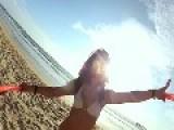 Girls And Hula Hoops On Beach