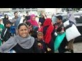 Grateful Migrants Showing Appreciation To Greek Volunteer