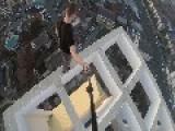 Guy Nonchalantly Walks On Edge Of Skyscraper