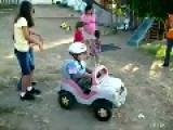 Girl Pushes Brother Downhill In Toy Car