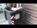 Guy Gets Stuck In A Garbage Can