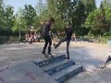 Guy Helps Friend Do Skateboarding Trick
