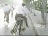 Guy Can Carry Bamboo Bundles On Bike