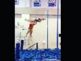 Girl Continuously Tries Grabbing Onto Gymnastics Bar