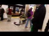 Guy Makes Music On The Subway Platform With Some Sort Of Mono-Stringed Instrument