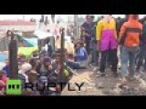 Greece: Refugees Try To Smash Police Barricade With Rolling Stock