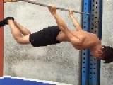 Guy Holds Himself Up Backwards On Pole