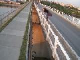 Guy Flies Over Gap Between Bridges