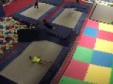 Girl Performs Flips And Other Tricks On Trampoline