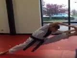 Girl Performs Drops Into Split Kick